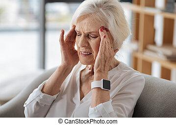 Unhappy gloomy woman having a headache - Strong pain....