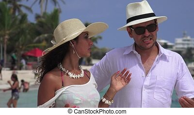 Unhappy Husband And Wife Talking At Beach