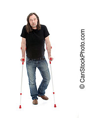 Unhappy injured or disabled middle-aged man walking with the aid of crutches, studio portrait isolated on white