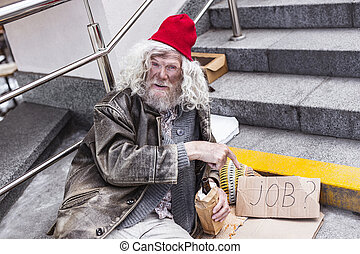 Unhappy jobless man pointing at the sign