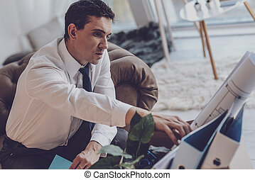 Unhappy jobless man thinking about his former job