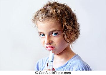 Unhappy kid girl with syringe medicine dose