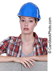 Unhappy looking female builder