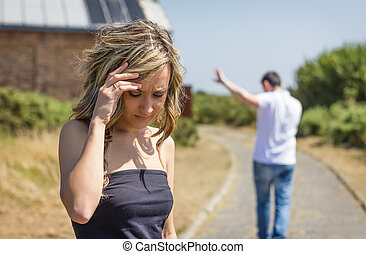 Unhappy man and angry woman leaving after quarrel