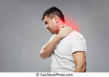 unhappy man suffering from neck pain