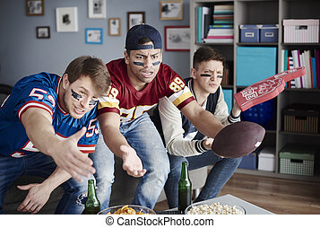 Unhappy men while watching American football