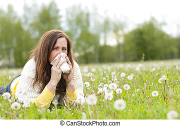 Unhappy middle age woman with hay fever and handkerchief