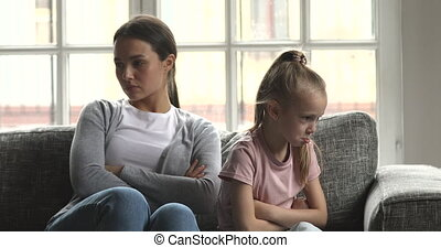 Unhappy mom and naughty child daughter avoid talk after ...
