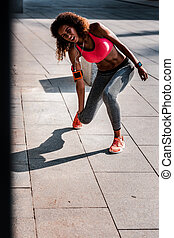 Unhappy nice young woman twisting her ankle