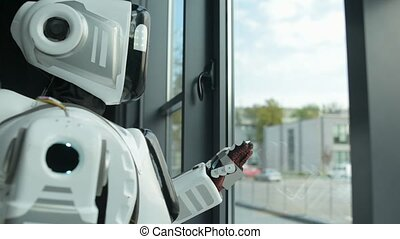 Unhappy robot dreaming about going out - One day I will go...