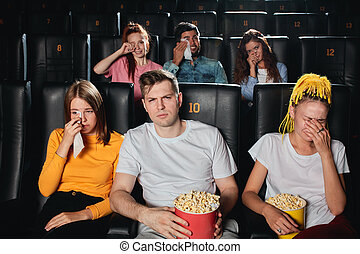unhappy sad audience at the end of the melodrama, drama