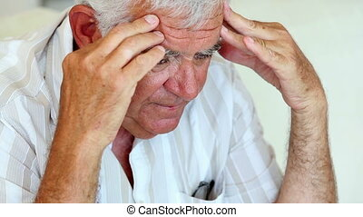 Unhappy senior man sitting on the c