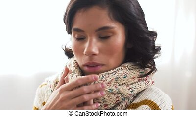 unhappy sick woman in scarf coughing at home - cold and...