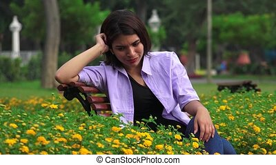 Unhappy Tearful Teen Girl Sitting Alone In Park