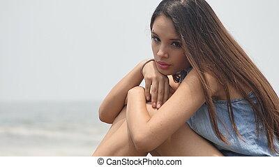 Unhappy Teen Girl At Ocean