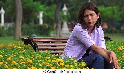 Unhappy Teen Girl Sitting Alone
