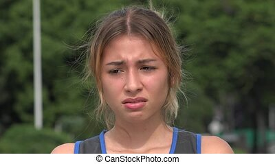 Unhappy Teen Hispanic Girl