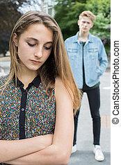 Unhappy Teenage Couple In Urban Setting