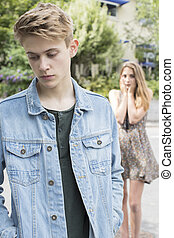 Unhappy Teenage Couple With Relationship Problem In Urban Setting