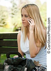 Unhappy teenager calling with mobile phone