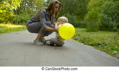 Unhappy toddler sitting on the road
