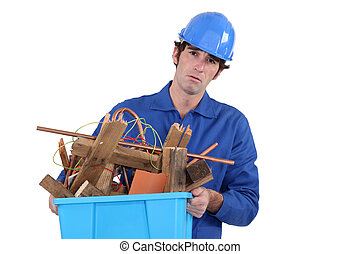 Unhappy tradesman taking out the recycling