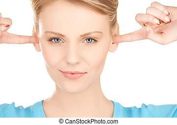 woman closing her ears with fingers