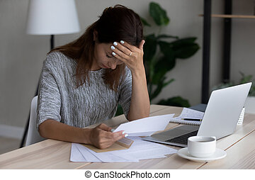 Unhappy woman feel distressed by bad news in letter