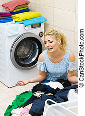Unhappy woman having a lot of laundry - Sad woman having a...