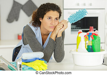 unhappy woman having to clean