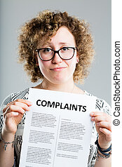 unhappy woman showing a complaints form