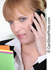 Unhappy woman talking on phone