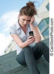 Unhappy woman with mobile phone