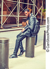 Unhappy Young African American College Student thinking on street in New York