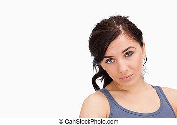 Unhappy young woman looking at camera