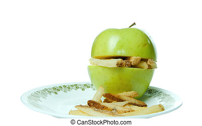 Concept image of unhealthy eating with an apple making a sandwich of french fries.