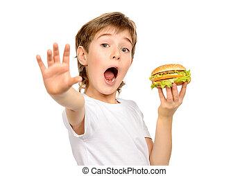 unhealthy food - A boy makes a choice against fastfood....