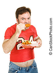 Unhealthy Stadium Food - Overweight middle aged man in tight...