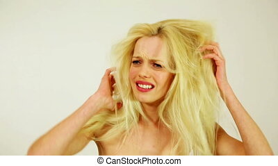 Unhealthy weak messy hair of unhappy young woman