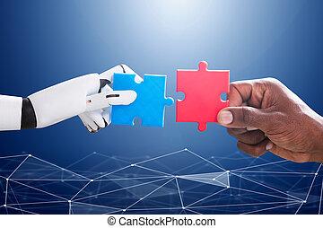 unión, rompecabezas, robot, mano humana