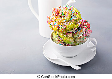 Unicorn donuts with coffee