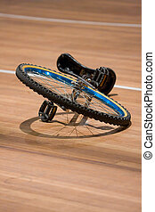 Unicycle - A unicyle lying on a wooden floor