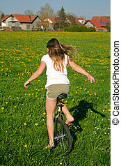 unicycle - young girl in field with her monocycle