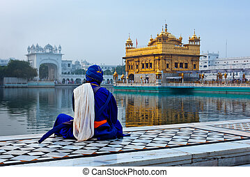 Unidentifiable Seekh Nihang warrior meditating at Sikh temple Harmandir Sahib. Amritsar, India