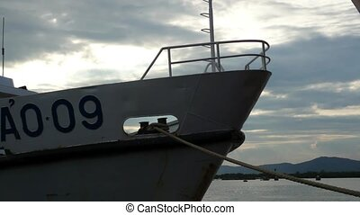 Unidentifiable white ship docked - Unidentifiable white ship...