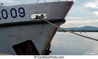 Unidentifiable white ship tied down - Unidentifiable white...