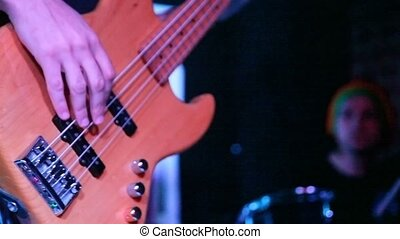 unidentified bass guitarist musician live on stage