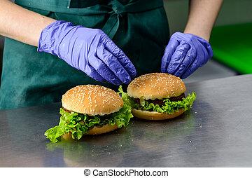 Unidentified chef preparing veggie burgers with yummy vegetable