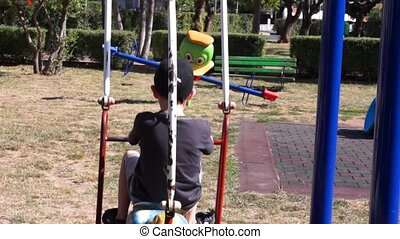 Unidentified child on a swing