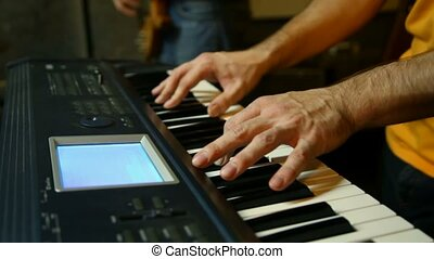 unidentified keyboard player playing in studio, vertical panning